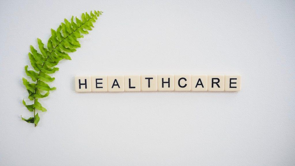 healthcare text screenshot near green fern leaf 2383010